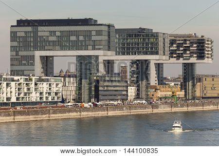 COLOGNE GERMANY - AUG 7 2016: The Crane Houses at the Rhine river in Cologne are contemporary landmarks of the city. North Rhine-Westphalia Germany