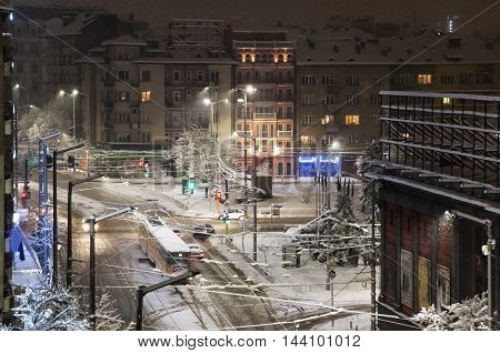 Sityscape with buildings and boulevard over Vazrajdane square, Sofia, Bulgaria during a snowy cold winter night.