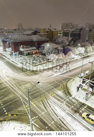 Sityscape with buildings and boulevards of Sofia, Bulgaria during a snowy cold winter night, vertical image.