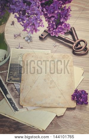 vintage background of old photos with keys on a table, retro toned