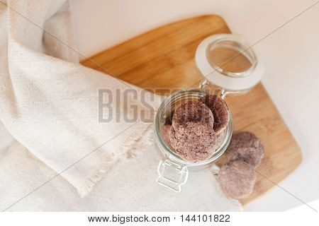 little chocolate cookies in a glass jar with a lid