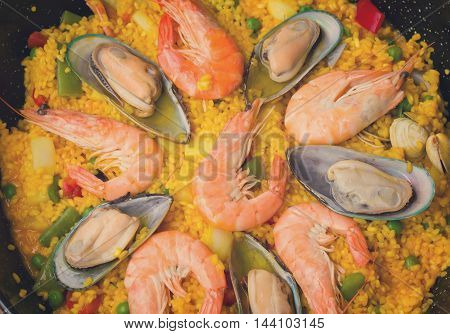 Paella background -traditional spanish rice dish, retro toned