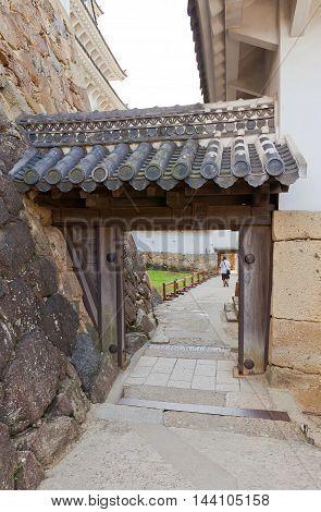 HIMEJI JAPAN - JULY 21 2016: Mizu-no-nimon (Second Water) Gate of Himeji castle (White Egret Castle circa 1609). Himeji-jo is National Treasure of Japan and UNESCO World Heritage Site
