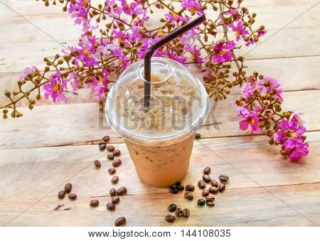 Iced Coffee With Straw  On Wooden  Background