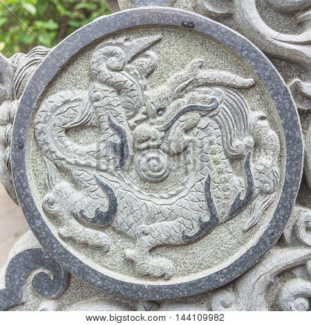 Sign of dragon on the stone in Wong Tai Sin Temple, Hong Kong.