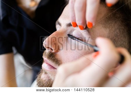 Portrait of woman making beauty and make up treatment in a saloon.