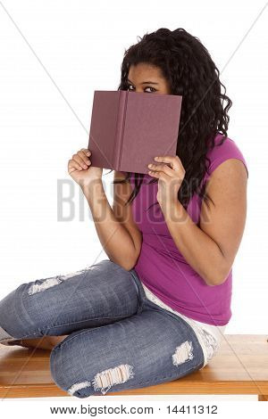 African American Peaking Over Book