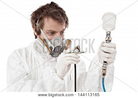 Worker with airbrush gun isolated on white background