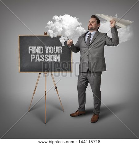Find your passion text on blackboard with businessman and paper plane