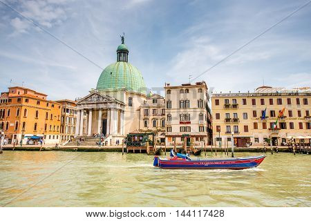 Venice, Italy - May 18, 2016: Cityscape view on the Grand canal with dome of San Piccolo Simeone church in Venice