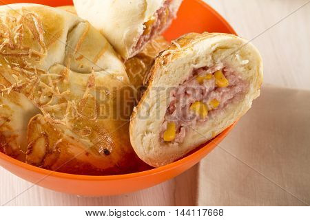 Brazilian snack fried with cheese ham on wooden background