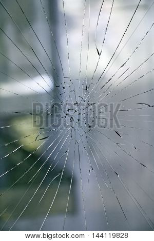 Broken glass on the window of the house as background