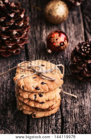 Stack of Chocolate Chip Cookies on a Wooden Table, Toned Image, Christmas Sweets. Rustic Style.