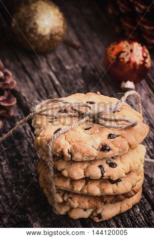 Stack of Chocolate Chip Cookies on a Wooden Table, Toned Image Christmas Sweets.