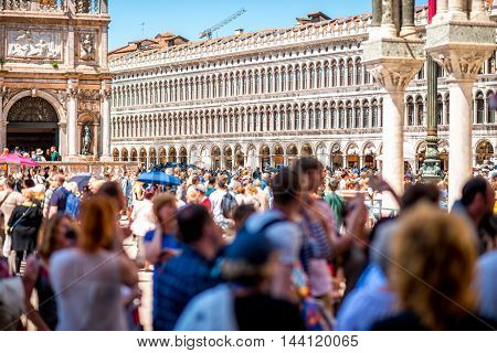 Venice, Italy - May 18, 2016: San Marks square crowded with people in Venice. This square is the most popular place among tourists in Venice