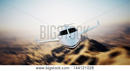 Photo of white modern and luxury generic design private jet flying in blue sky at sunrise.Uninhabited desert mountain background.Business travel picture.Horizontalmotion blurred effect. 3D rendering