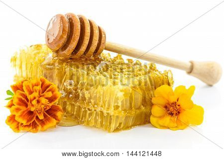 Fresh honey with honeycomb and flowers isolated on white background