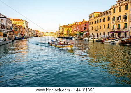 Venice, Italy - May 18, 2016: Cargo boat swim delivering goods on Grand canal in the morning in Venice.