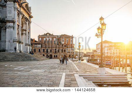Venice, Italy - May 18, 2016: Campo della Salute with Santa maria church on the sunset in Venice