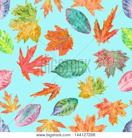 Seamless pattern with bright autumn leaves painted in watercolor on a turquoise background