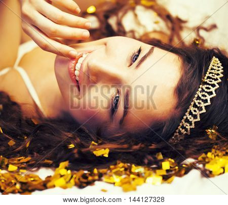 beauty young girl in gold confetti and tiara, little princess celebration close up