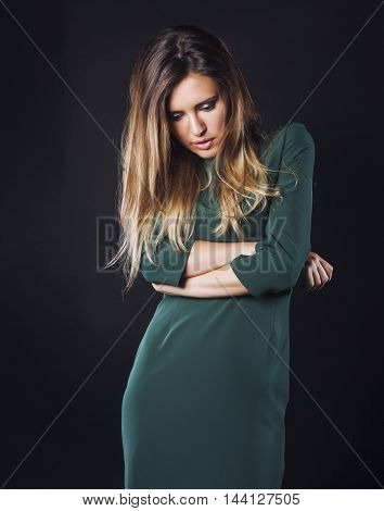 young blond real woman emotional sad face in depression dark indoor, lifestyle people concept