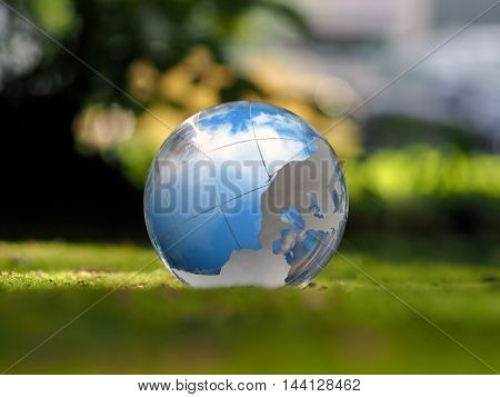 Transparent sphere. Reflection of the sky. Green moss. The concept of ecology environmental protection safety serenity
