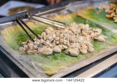 The Opened fresh Oysters on banana leaf