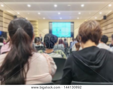 Motion blur of view of seminar with audience in a seminar room background