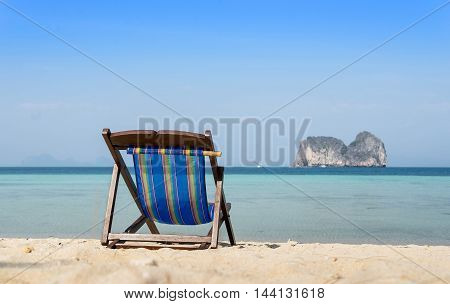beach chair on sand and sea view on background