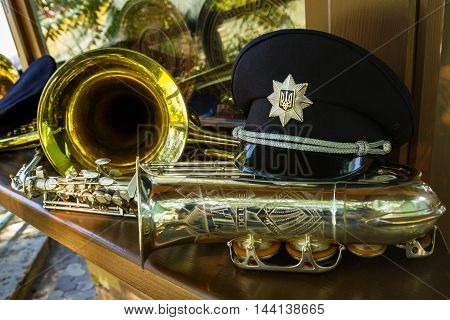 Uzhgorod Ukraine - August 25. 2016: Police cap and saxophone on the counter boutique during the ceremony of awarding titles to inspectors of police officers.