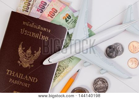 Thai Passport With Thai Money Banknote, Thai Coin And Airplane. The Passport Of Thai Citizen And Tha
