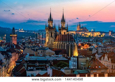 Night aerial view to Prague old town with Tyn church and St. Vitus cathedral