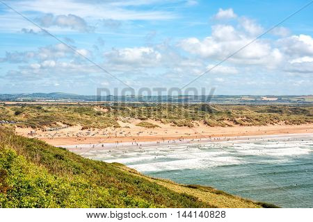 Braunton United Kingdom - August 13 2016: Saunton beach is a key component of North Devon's golden coast part of UNESCO Biosphere Reserve. It is popular beach with surfers and families.