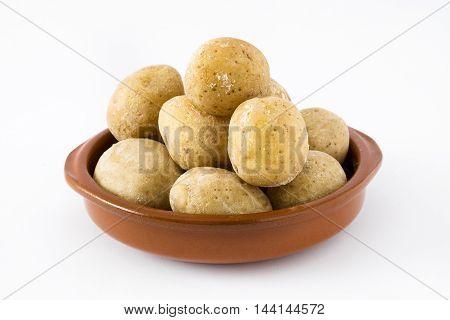Canarian potatoes (papas arrugadas) isolated on white background