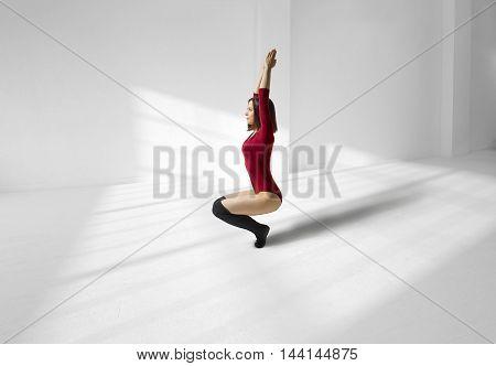 Beautiful yoga posing on a white studio background