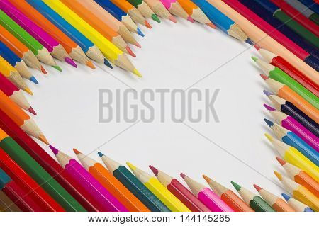 Collection of colorful pencils as a background picture in a heart shape