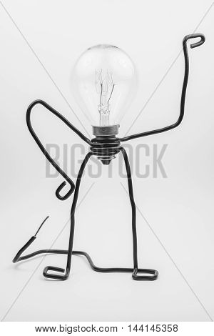 Emotional fantasy figure of a transparant light bulb and black electrical wires