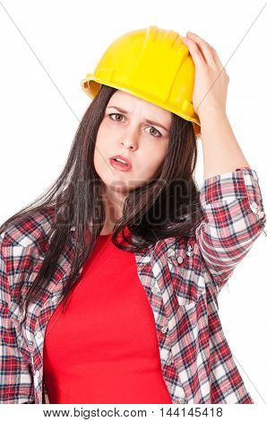 Upset pretty woman in a protective helmet isolated on white background