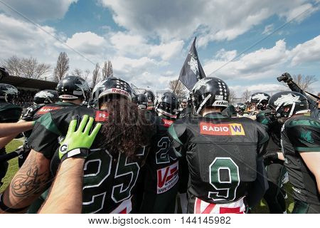 VIENNA, AUSTRIA - APRIL 4, 2015: The team of the Danube Dragons is in the huddle before a game of the Austrian Football League.