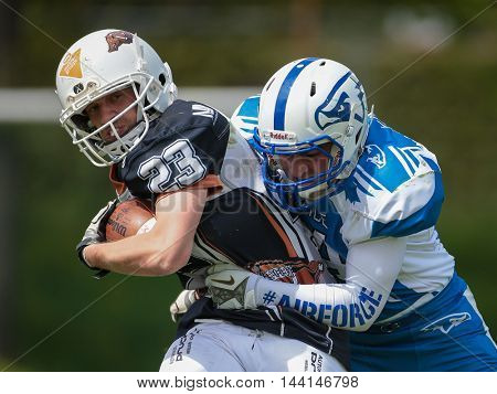 TULLN, AUSTRIA - APRIL 26, 2015:  Players fight for the ball in a game of the Division IV of the Austrian Football League.