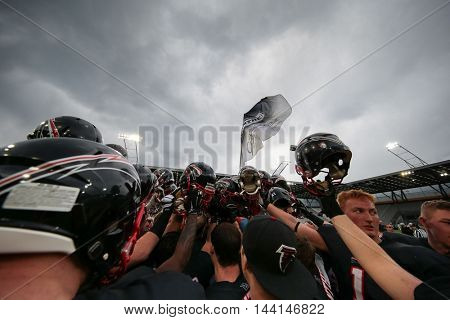 INNSBRUCK, AUSTRIA - APRIL 11, 2015: The team of the Duesseldorf Panther in the huddle before a game of the Big Six Football League.