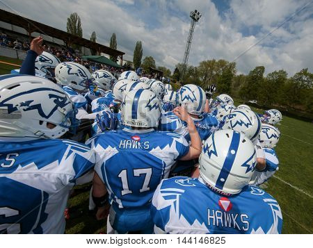 TULLN, AUSTRIA - APRIL 26, 2015: The team of the Air Force Hawks in the huddle before the game of the Division IV of the Austrian Football League.