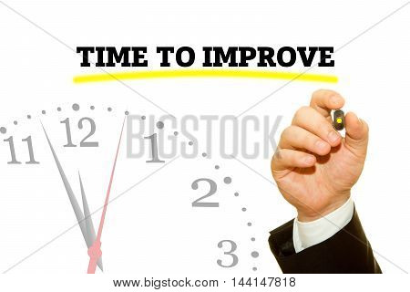 Businessman hand writing TIME TO IMPROVE message on a transparent wipe board.