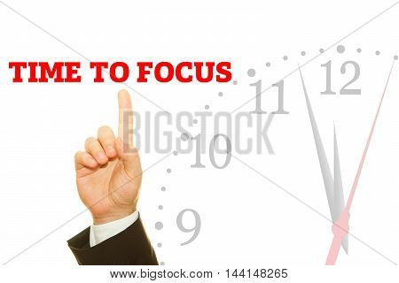 Businessman hand writing TIME TO FOCUS message on a transparent wipe board.