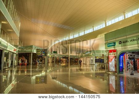 BARCELONA SPAIN - JULY 14 2016: The public area at the Terminal T1 of El Prat-Barcelona airport.