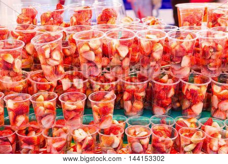 Strawberries in plastic cup for making juice.