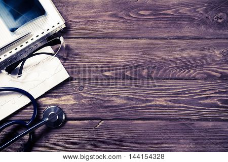 High angle shot of medical items on wooden table