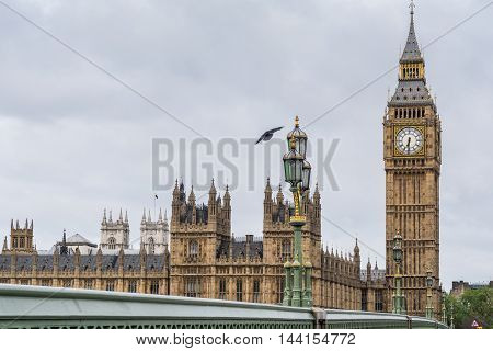 Big Ben and parliament houses on a cloudy morning in London England