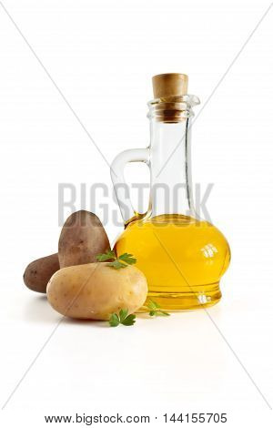Sunflower oil in the bottle boiled potatoes parsley and a pinch of salt isolated on white background